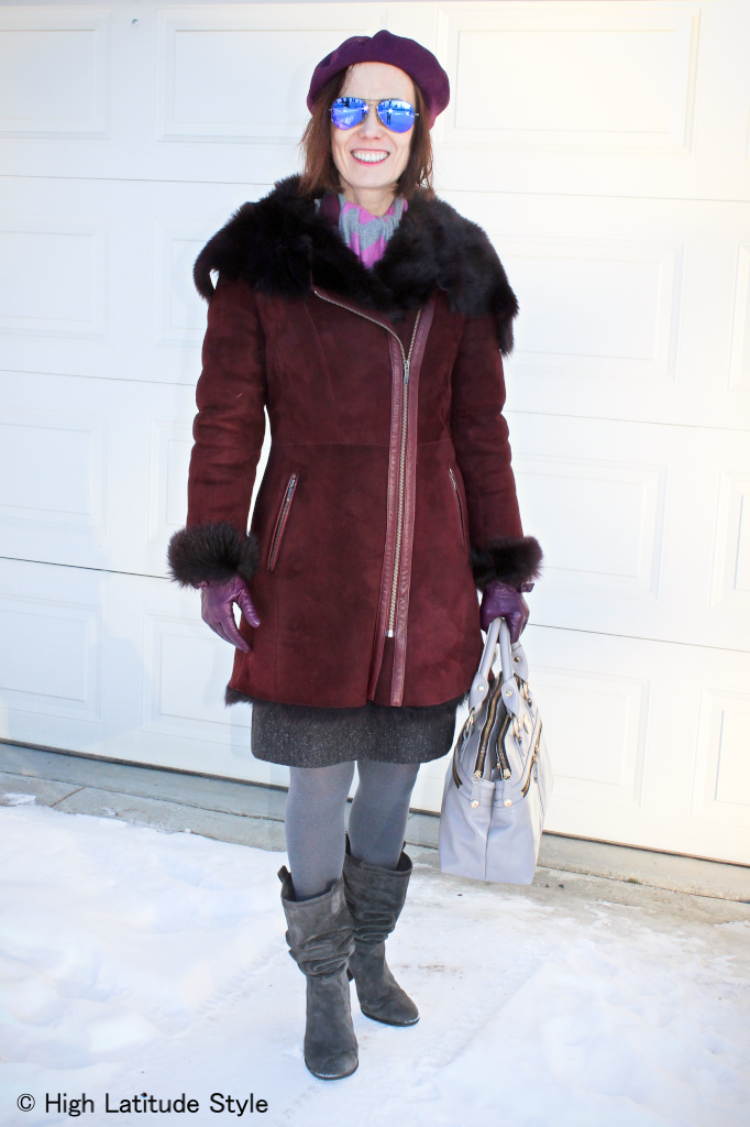 #fashionover50 mature fashion blogger in motorcycle shearling coat with mirrored sunglasses that create interest in this winter outfit