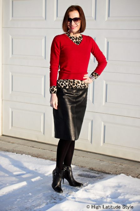 layer cardigan under v-neck sweater with leather skirt