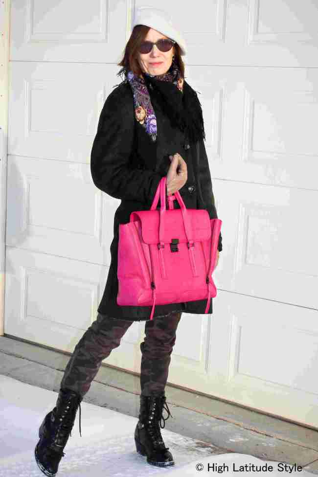 #fashionover50 midlife blogger in fashion camo pants and a shearling coat with fuchsia bag