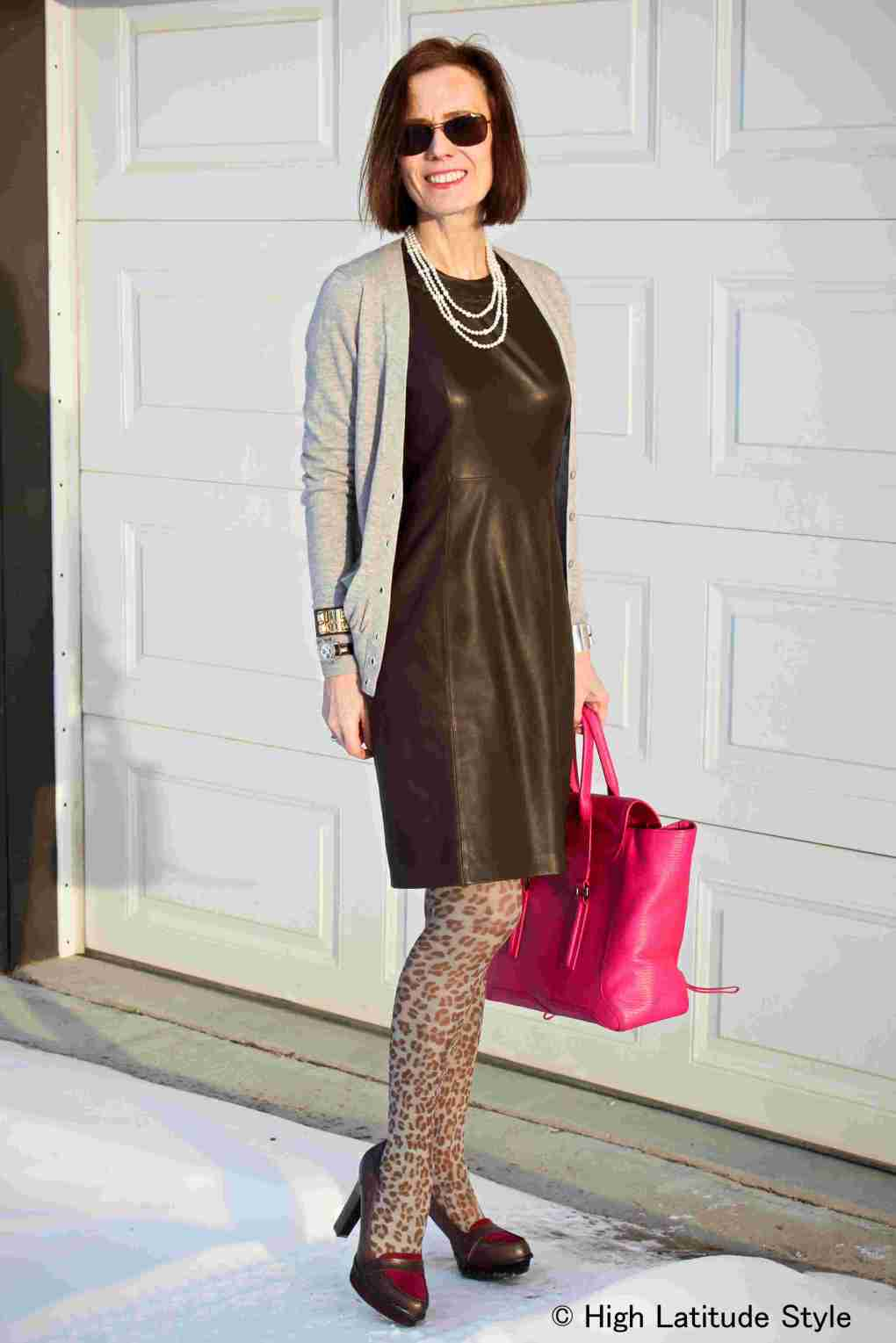 #fashionover40 woman in leather sheath