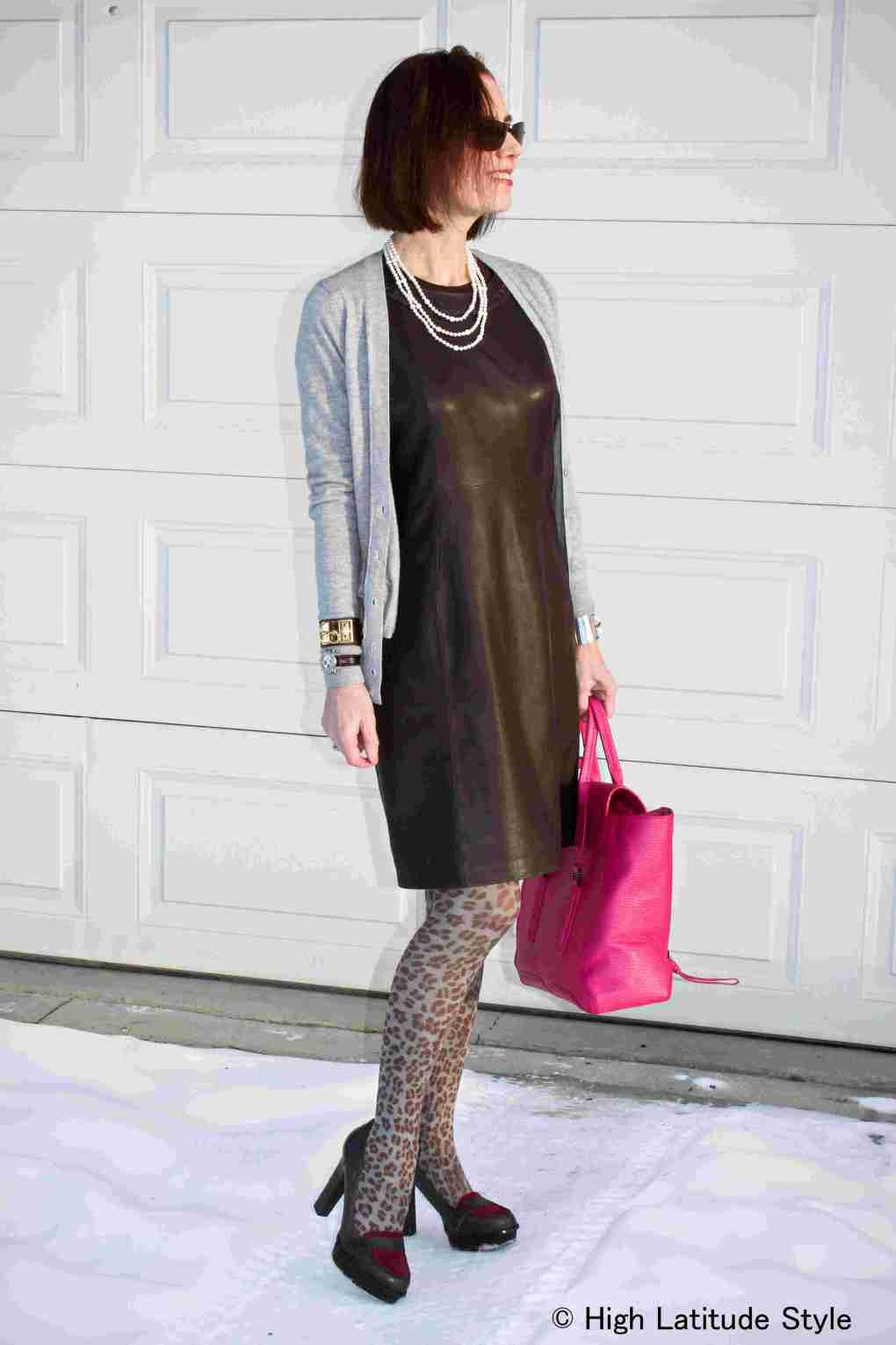 #styleover40 woman wearing a sheath dress with leopard print tights