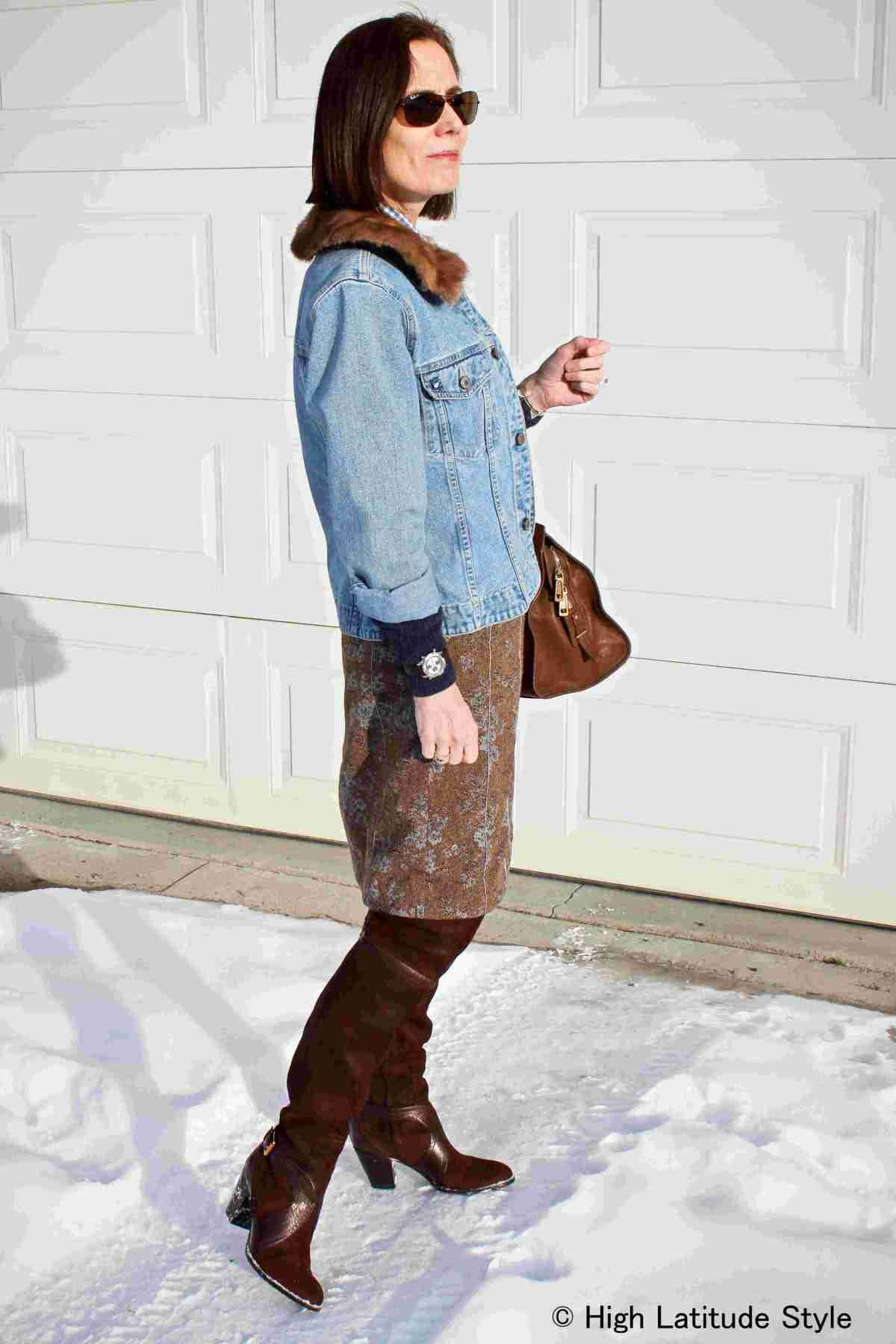 over 50 years old woman in denim and tweed work look in brown and blue