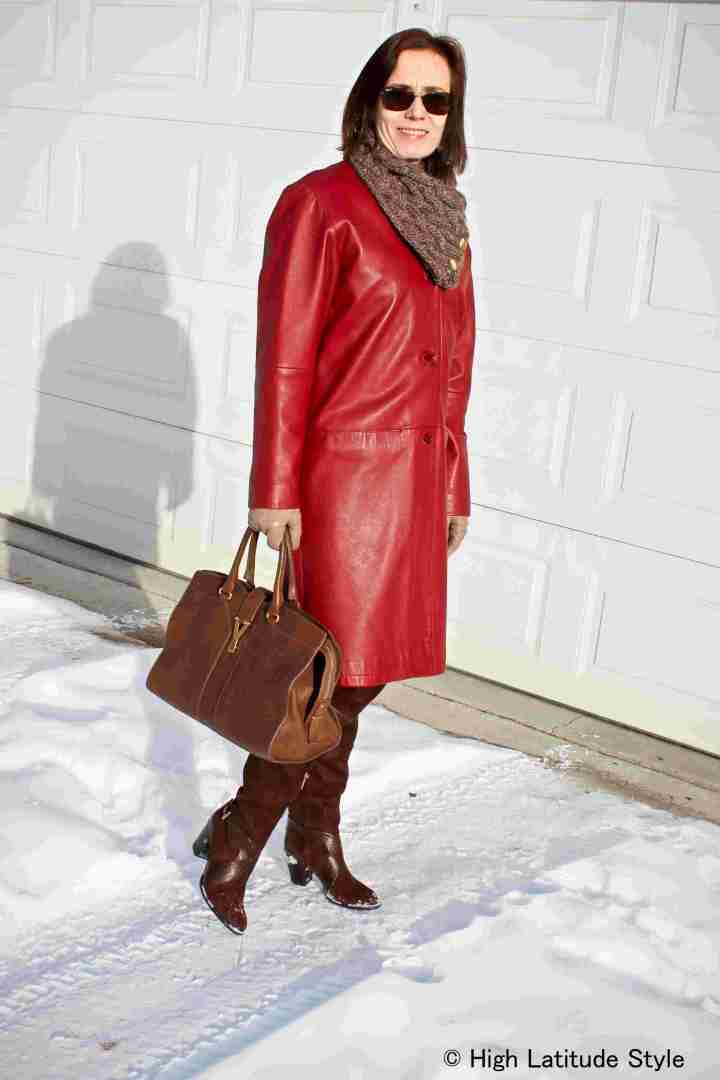 #advancedstyle midlife woman in posh boxy leather coat, scarf, Over-the-knee boots, and sunglasses