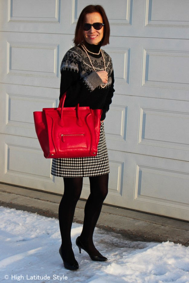 #fashionover50 mature fashion blogger wearing a sweater over a sheath dress as a skirt and sweater look