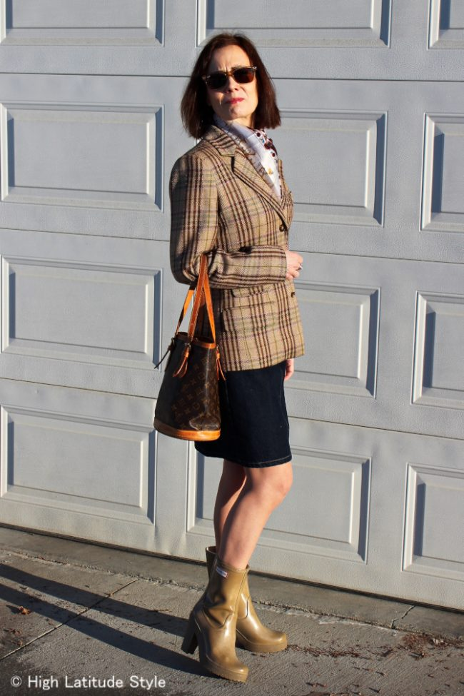 stylist in Alaska spring work outfit with plaid blazer, denim skirt, pantyhose and rainboots
