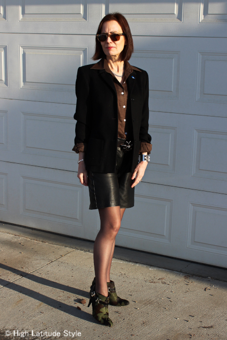 over 50 years old woman in leather shorts with tight, blazer and shirt