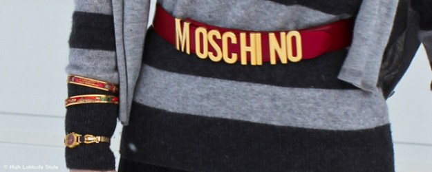 red and gold colored Moschino belt