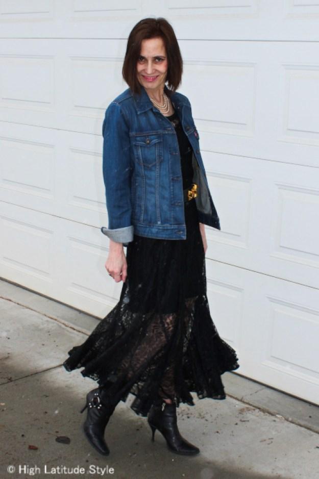 senior women in long black lace dress with denim jacket