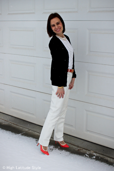 stylist in black and white trend with leather pants and layered cardigans