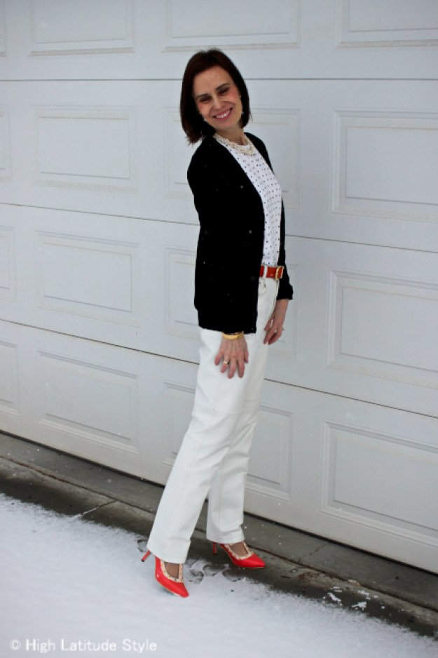#over40fashion mature Alaskan woman dressed for April showers with leather pants and layered cardigans