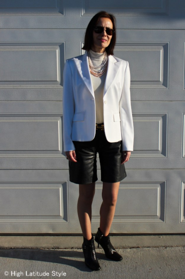 Spring look with leather shorts with white on winter white blazer and sweater