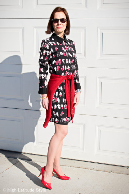 #fashionover50 mature woman in Victoria Beckham dress with rust cardigan and red pumps