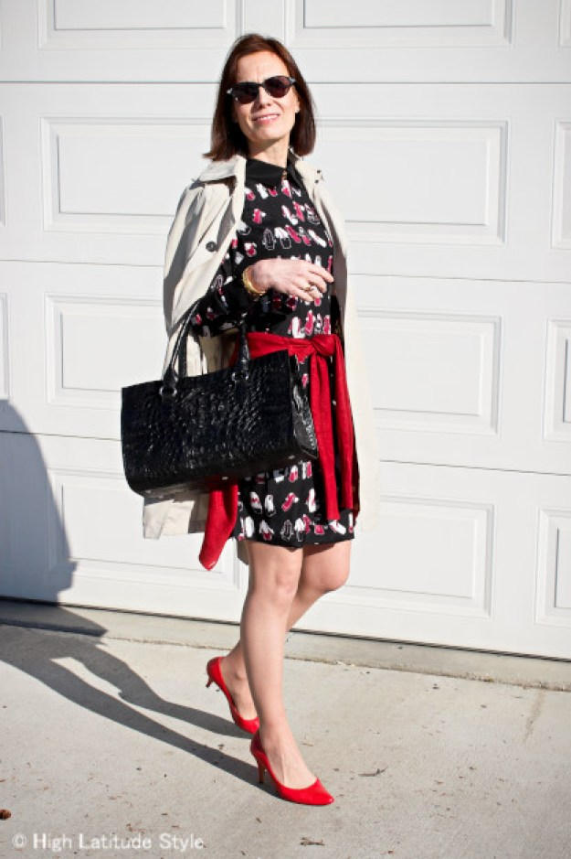 style blogger in Victoria Beckham dress with rust cardigan and red pumps styled for Mom's special day
