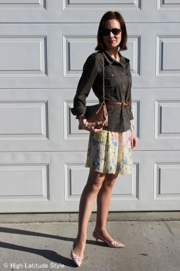 blogger Nicole in yellow pastel floral skirt with blush pointy toe slingbacks, Chanel bag, utility jacket and belt