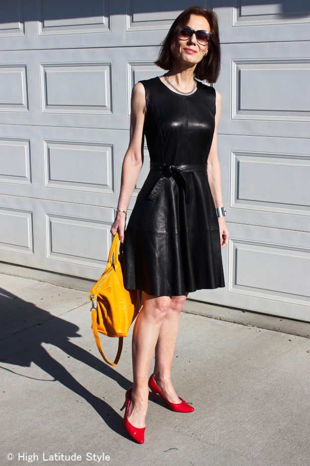 mature women in a fashionable fit-and-flare leather dress