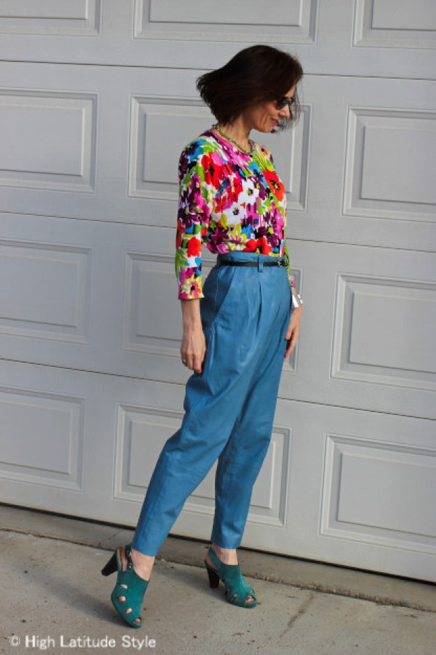 fashion blogger with floral top and leather pants