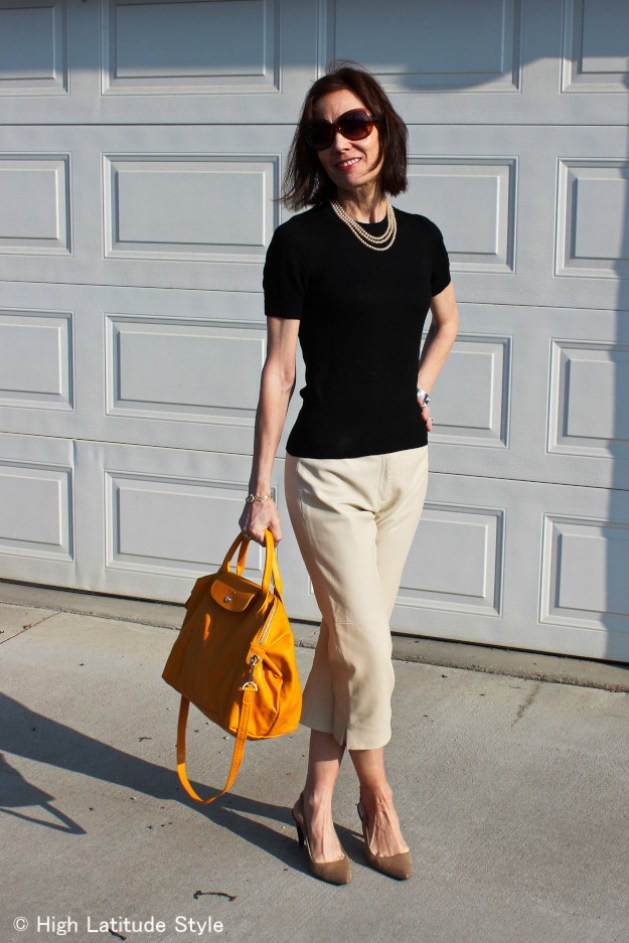 fashion blogger in classic American outfit wearing sling backs