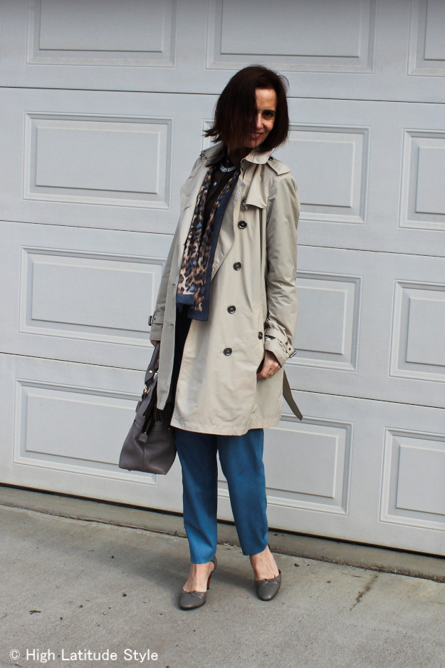 stylist in all neutral non-boring outfit with trench and leather pants, scrf