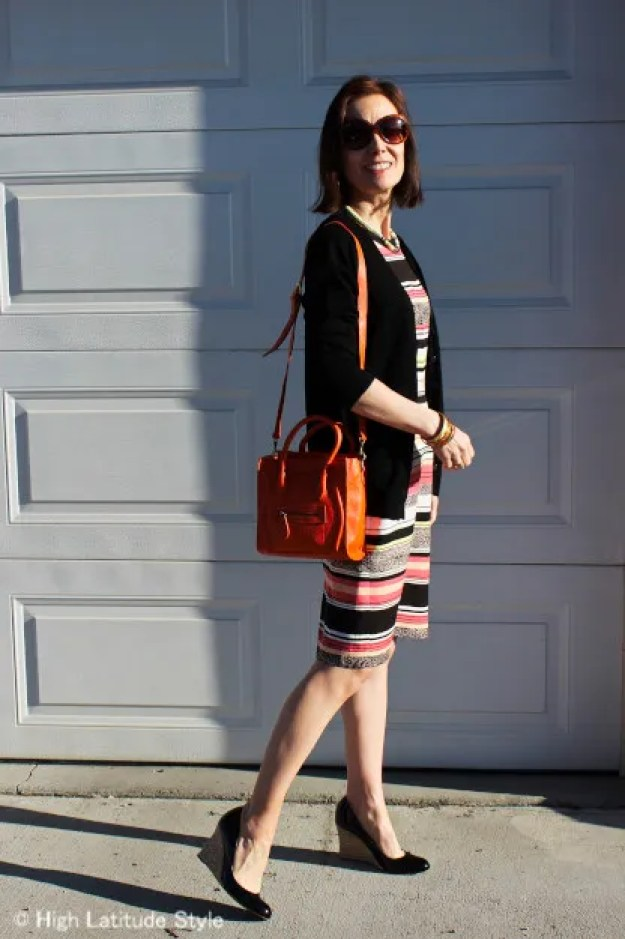 over 50 years old blogger styling a sheath dress with comfortable patent leather wedges