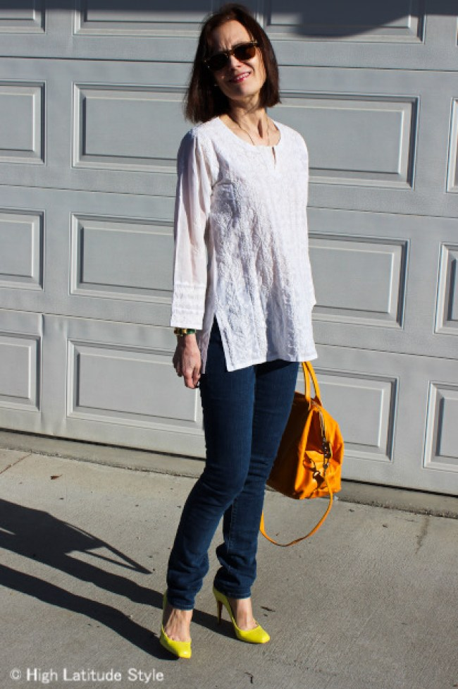 mature stylist in an outfit with ethnic shirt styled in a western way with skinnies and pumps