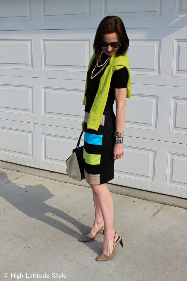 outfit with striped skirt two sweaters, sling backs, sunglasses and pearls
