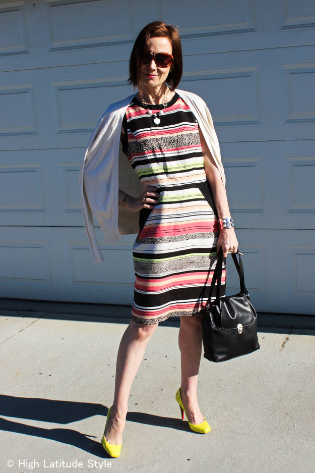 #midlifestyle woman in sheath dress with necklace