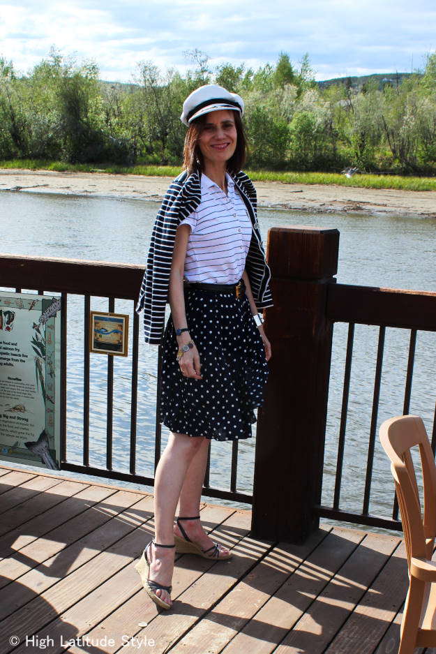 stylist in an outfit for dinning out on the river in summer in nautical blue and white with stripes