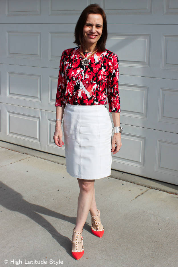 #fashionover40 woman in abstract floral print top with leather skirt for the office