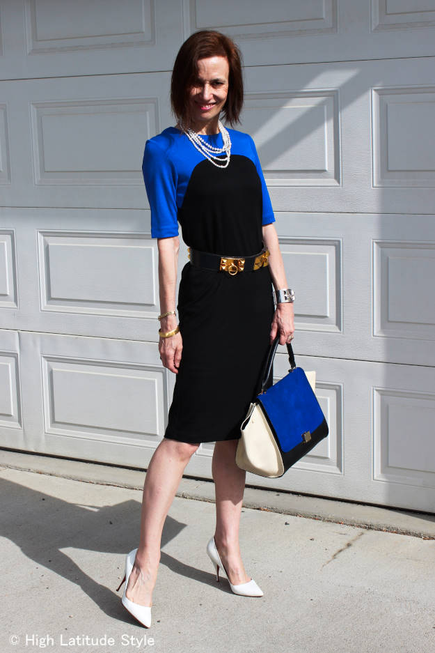 fashion blogger looking chic in a black and royal blue jersey Ronen Chen jersey dress