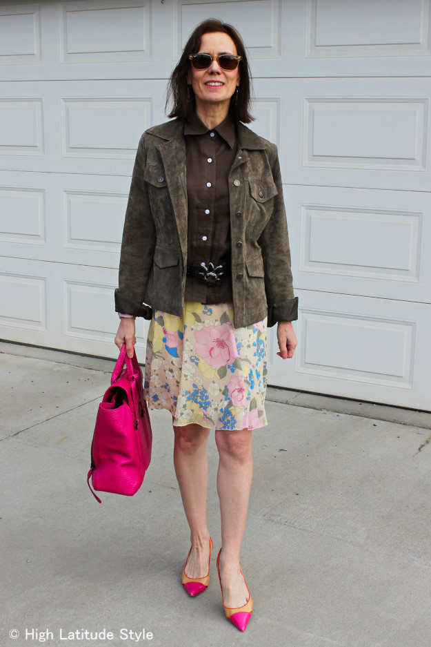 over 50 years old woman in suede utility jacket, button-down shirt, pastel floral skirt