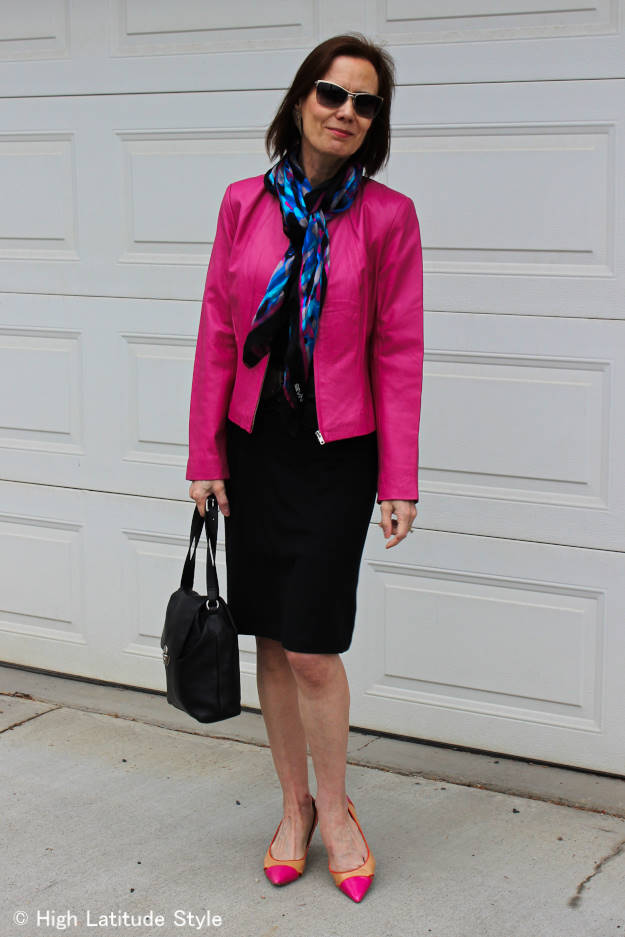 style blogger in color clocked fuchsia, black an royal blue dress with jacket look