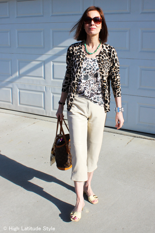 #advancedstyle woman in leopard Print Cardigan with floral Tank Top and leather Capri in Alaska