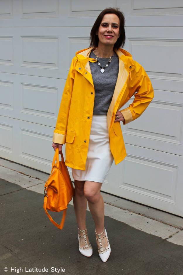 fashion blogger over 50 wearing a man's raincoat