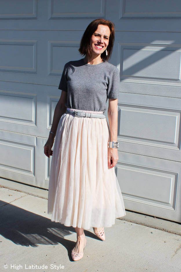 #advancedstyle woman in nude mesh tulle skirt styled with blush pinks