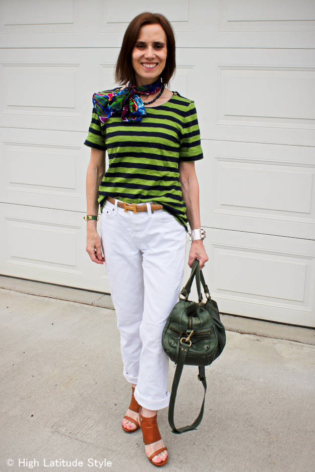 #fashionover50 woman dressed for a shorts event in colors similar to the green, white and blue of the team