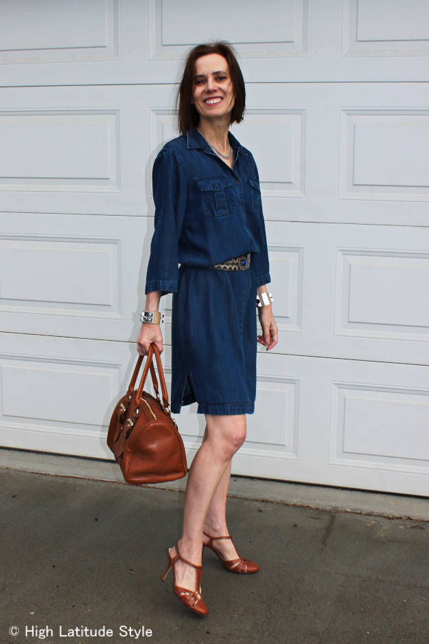 #fashionover50 older woman looking posh chic in a denim dress and T-strap sandals