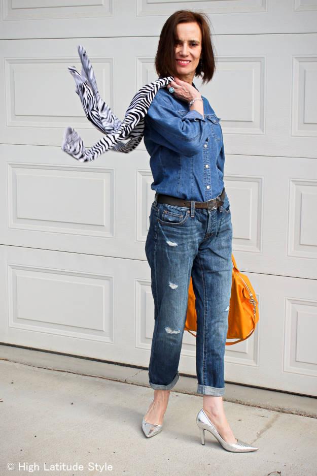 stylist in distressed jean, denim shirt and zebra cardigan