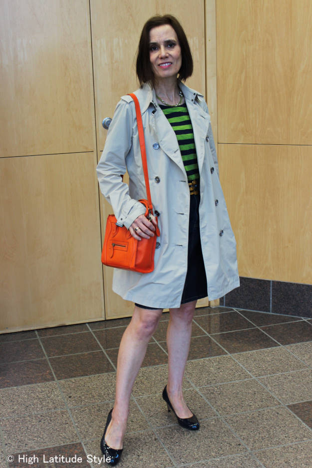 style blogger Nicole in denim skirt with striped shirt and trench coat