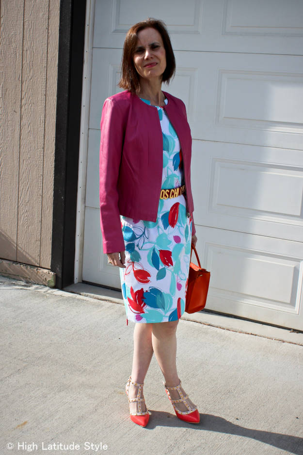 over 50 years old blogger in summer work outfit with abstract print sheath and belt