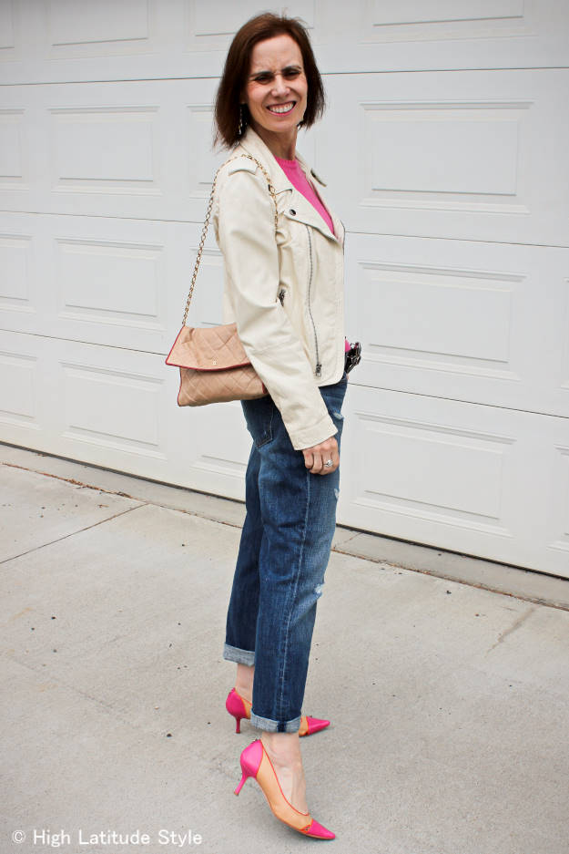 fashion blogger in white motorcycle leather jacket, distressed BF jeans