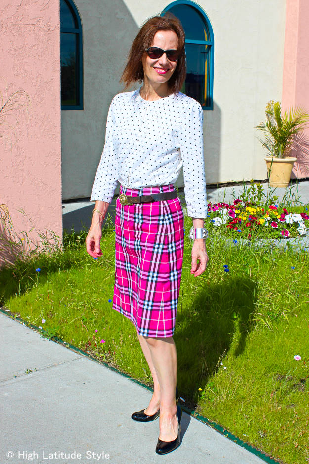 older woman in a plaid skirt with polka dot top