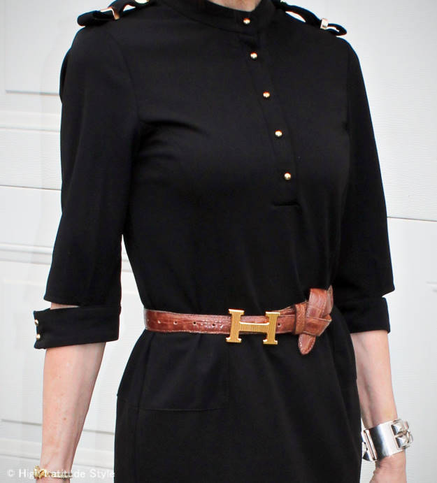 H buckle styled with knotted belt and military dress