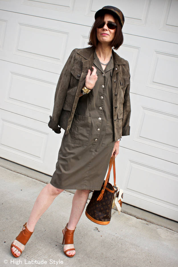 #fashionover50 mature woman in military inspired shirt dress with camouflage hat