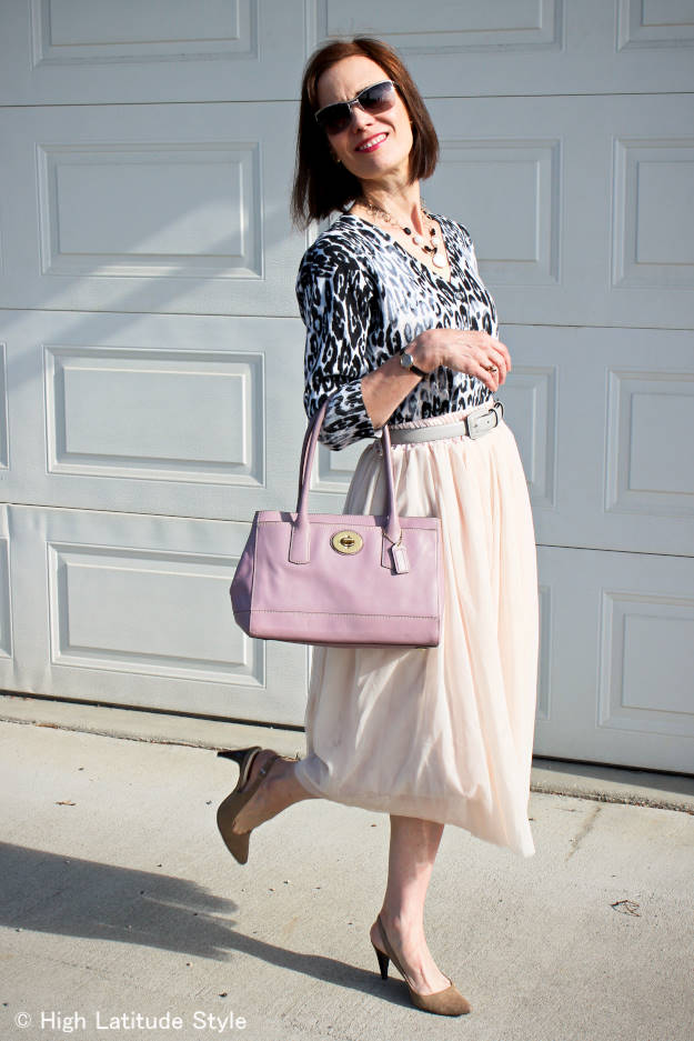 fashion blogger in snow leopard top with blush mesh skirt