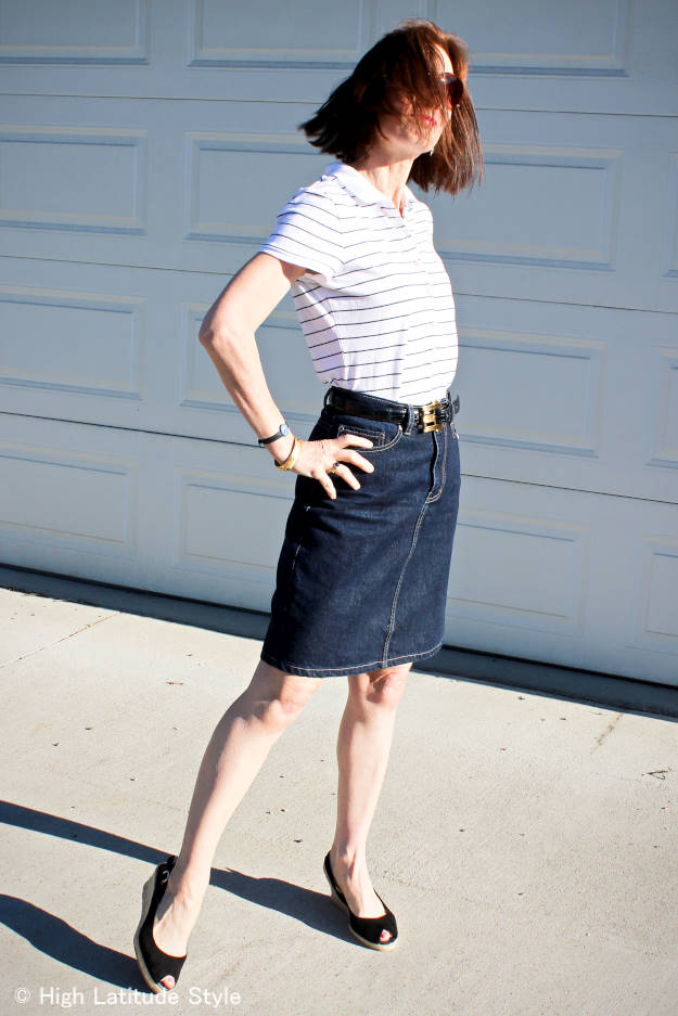 over 50 years old style blogger in Jackie O sunglasses and denim skirt