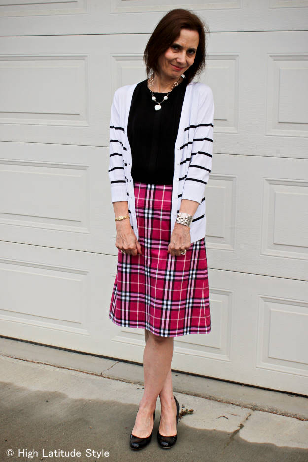 #fashionover40 woman in an outfit with stripes and plaid