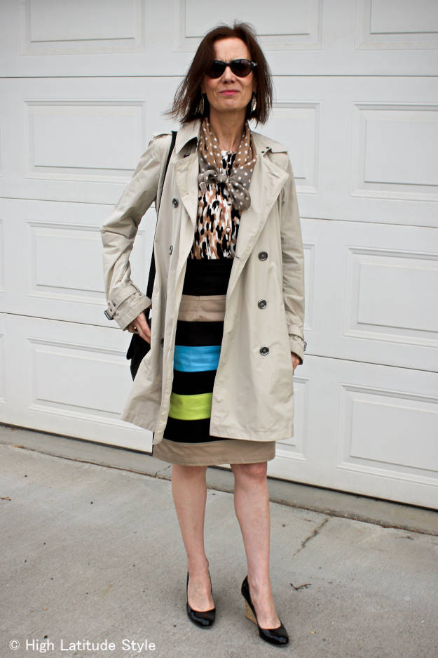 #fashionover40 woman in trench coat and striped skirt