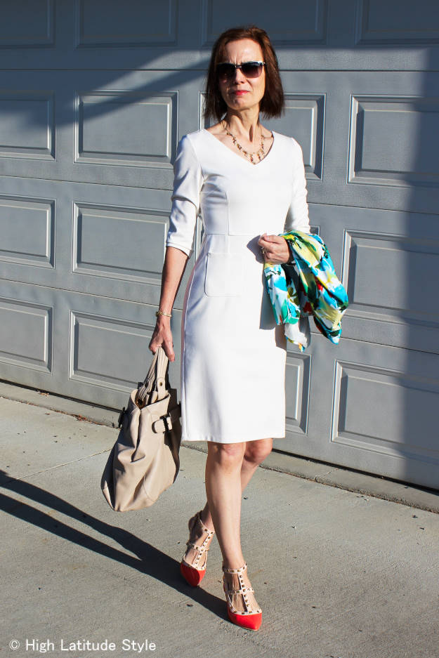middle age woman wearing a winter white v-neckdress
