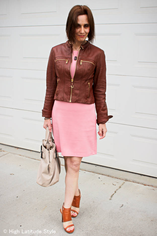 #fashionover40 mature woman in motor cycle jacket and dress