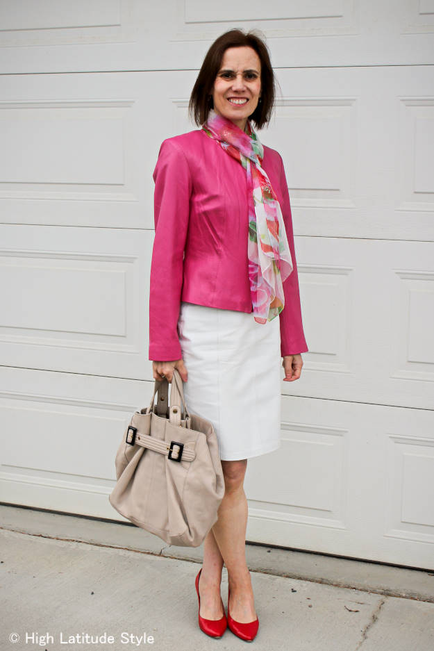 #styleover50 woman wearing a leather skirt and coat